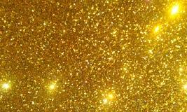 Золотой яркий блеск текстурировал предпосылку, яркий красивый сияющий золотой яркий блеск стоковое изображение