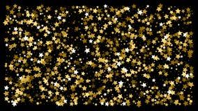Золотой confetti звезды яркого блеска на черной предпосылке стоковое фото