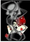игрок. Карты,кости на фоне дыма и черепа.Cards, dice amid smoke and skulls Stock Photography
