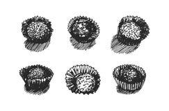 Иллюстрация руки вектора вычерченная иллюстрации конфеты на белой предпосылке бесплатная иллюстрация