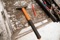 Инструменты для устанавливать стены дома стоковое изображение