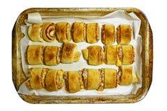 Испеченные крены мяса на старом печь листе стоковое фото