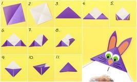 Как сделать форму закладки бумаги Origami зайчика для приветствий пасхи принципиальная схема diy Постепенная инструкция фото стоковое фото rf