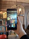 Книги в телефоне стоковое фото rf