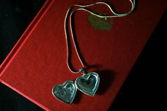 Heart pendant on the book stock photography