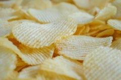 Кудрявая предпосылка текстуры закуски картофельных стружек стоковое изображение