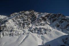 Красивые горы Snowy Крита Bataillence в Aragnouet Природа, перемещение, ландшафты 29-ое декабря 2014 Aragnouet, полдень стоковое изображение