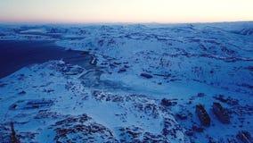 Красивый вид с воздуха захода солнца в Teriberka России во время зимы акции видеоматериалы