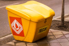 Yellow sand container for road safety. Safety on the roads of Krasnodar with sand Royalty Free Stock Images