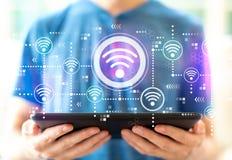 Концепция Wifi с человеком используя планшет стоковая фотография rf
