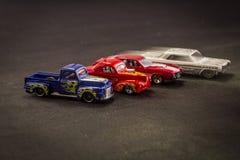 Масштабные модели тележек игрушки металла на черной предпосылке стоковое фото rf