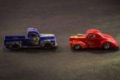 Масштабные модели тележек игрушки металла на черной предпосылке стоковое фото
