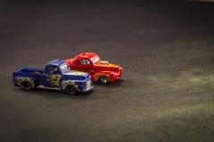 Масштабные модели тележек игрушки металла на черной предпосылке стоковое изображение rf