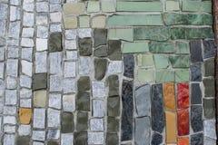 Мозаика из разноцветных камней с цементом. Mosaic of multicolored stones, fastened with cement Royalty Free Stock Photo