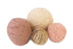 нитки для вязания. A ball of yarn for knitting on white background Stock Photos
