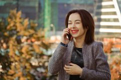 Нappy woman talking on and laughing on the mobile phone stock photos