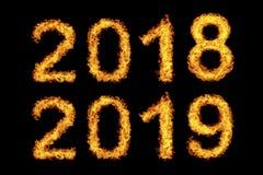 Новый Год 2018 до 2019 сделанные из пламени огня стоковая фотография