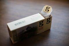 Пакет чая Грейс на деревянной предпосылке стоковое фото