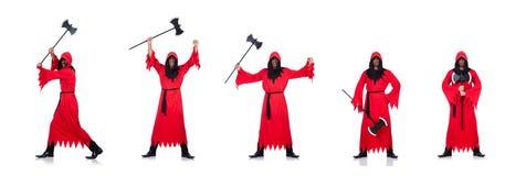 Палач в красном костюме с осью на белизне стоковое фото rf