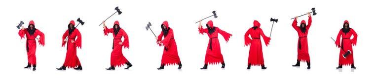 Палач в красном костюме с осью на белизне стоковое фото