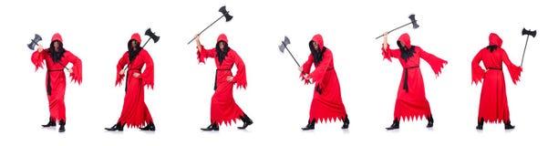 Палач в красном костюме с осью на белизне стоковая фотография