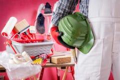 Профессиональный маляр на работе на строительной площадке Строить стоковая фотография rf