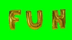Потеха слова от писем воздушного шара золота гелия плавая на зеленый экран - акции видеоматериалы