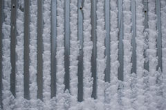 Полоски металла со снегом. Strips of grey metal is covered with snow Stock Photo