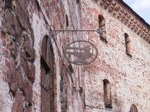 Ðœedieval在墙壁上的牌铁匠铺 库存图片