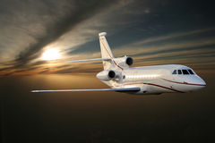 �orning flight. Jet plane above Earth Stock Photo
