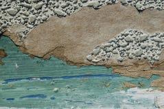 Оld在蓝色的被撕毁的墙纸 免版税库存照片