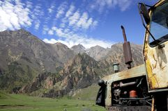 Оld tractor in mountain Stock Photos