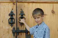 �oy about the wooden house Royalty Free Stock Images