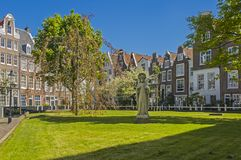 Begainhof courtyard in Amsterdam on a sunny day stock image