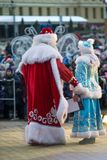 Father Frost and the Snow Maiden congratulate people merry Christmas royalty free stock photos