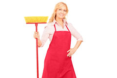 Мature female cleaner with brush in her hand Royalty Free Stock Image