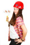 Ð  dziewczyna w budynku hełmie z malarza rolownikiem w ręce Obrazy Stock