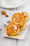 А group of fritters of cottage cheese with honey and nuts. Fritters of cottage cheese with honey and nuts on a white plate Royalty Free Stock Photography