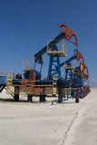 Оil pump jack. Oil and gas industry. Work of oil pump jack on a oil field Royalty Free Stock Photos