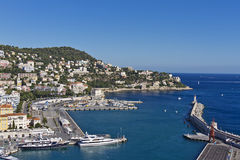 Оld harbor and numerous ships and yachts in Nice. Beautiful view of the old harbor and numerous ships and yachts, made from the Castle Hill in Nice. France Stock Photos