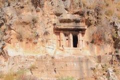 Ð- ncient Lycian-Grab, das im Felsen verringert wird Fethiye, die Türkei Lizenzfreie Stockfotografie
