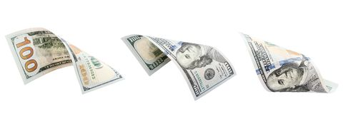 3 100 доллары изолированные на белой предпосылке Новые 100 долларов стоковое изображение