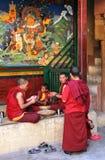 Ьonks at Lamayury monastery making traditional staple food 'Tsampa' Royalty Free Stock Photos