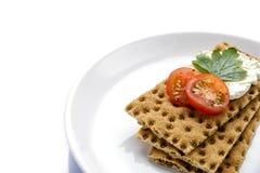 Ð-¡ rispbread och ny tomatoe Fotografering för Bildbyråer