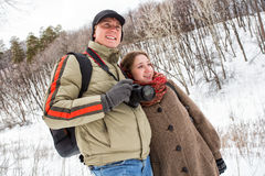 A young couple in the winter forest Stock Photo