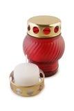 свеча в красном подсвечнике. Wax candle in a red candlestick isolated on white background Stock Image