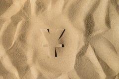 Символ иен под песком стоковое фото rf