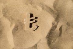 Символ лиры под песком стоковое фото