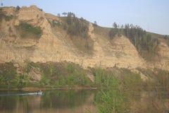Скалы и река. Landscape rocks in the Irkutsk region , the river white stock photos