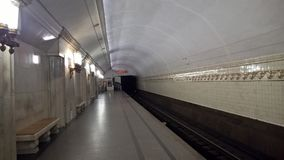 Moscow, Russia, Metropolitan, `Smolenskaya` metro station, Peron with lamps - torches stock photos